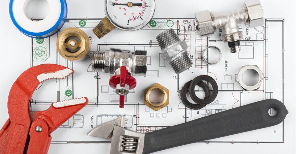 plumbing tools and equipment on blueprint